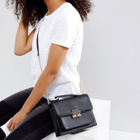 Qupid Crossbody Bag With Buckle Detail And Chain Strap at asos.com