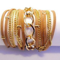 5X Wrap Bracelet with a brown Suede cord, 2 gold brass Chains and Twisted Rhombus gold Chain