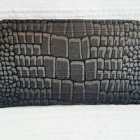 Clutch crocodile skin design, closed with a zip, shinny black, grey, gold brown glints, casual chic