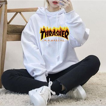 ThrasherMen and women with the flame hooded couples sweater Black-yellow letters White