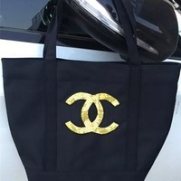 Chanel's new women's single shoulder bag black pearlescent golden pearlescent light on the shoulder bag shopping bag