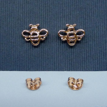 A rose gold plated honey bee earrings, A minimalist earrings, A cartilage/tragus ring