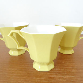 Three yellow Independence Ironstone Castleton pattern cups