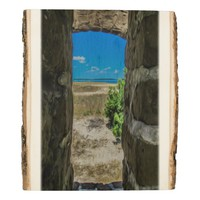 Looking Out a Brick Window at the Beach and Sea Wood Panel