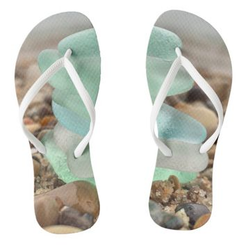 Seaglass and sand flipflops