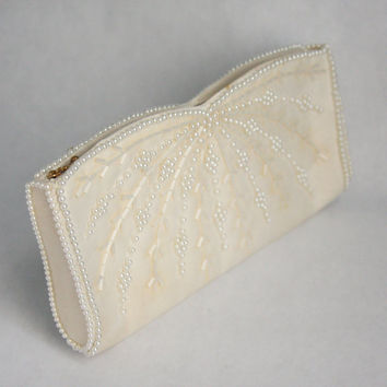 Vintage 1960's white zipper clutch with pearl beads and bugle beads by La Regale