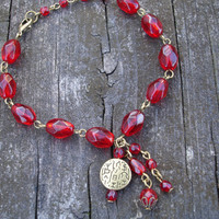 Red bracelet with antiqued bronze, dark red glass faceted oval beads, bronze accents