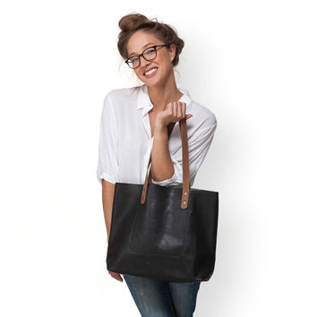 Large black leather bag by Leah Lerner