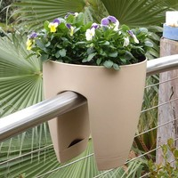 modern, sleek saddle planter for balconies and railings, indoors and out.White plant pot for railing fence