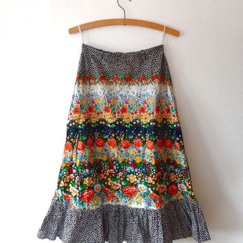Floral gypsy skirt. ditsy floral. colourful. flower print. black. white. orange. red. green. retro. vintage. 1970s. frill. button midi skirt