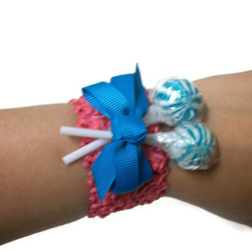 Hot pink and blue lollipop wrist corsage, pink, blue, corsage, prom corsage, wedding corsage, mother of the bride, mother of the groom
