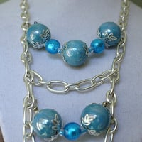 Multi strand chain and ceramic beads necklace