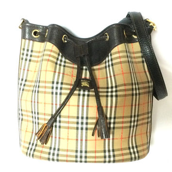 Vintage Burberry classic brown nova check hobo bucket shoulder bag with dark brown leather trimmings and drawstring tassels. Unisex