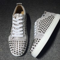 KUYOU Christian Louboutin red sole classic rivet Roller-Boat CL white low-top sneakers