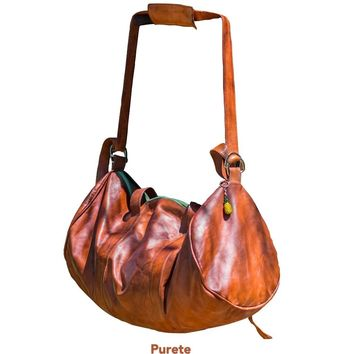 purete👍🏽 soft leather weekend duffel bag with colored accents | bati signature design