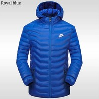 NIKE winter new sports and leisure detachable hat warm down cotton padded clothes Royal blue