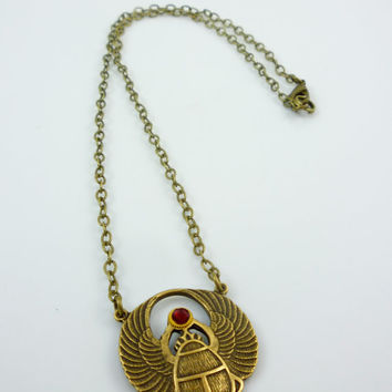 Vintage Design Antique Brass Egyptian Winged Scarab Necklace with gear andBlood Red Swarovski Crystal