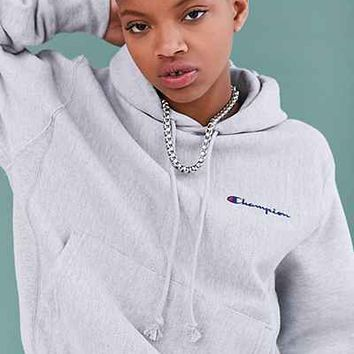 Champion + UO Mini Logo Hoodie Sweatshirt from Urban Outfitters 22d7a388b0ed