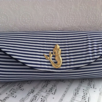 Nautical navy blue clutch bag with gold mermaid