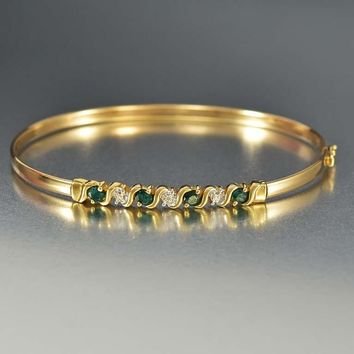 Estate Gold Diamond and Emerald Bangle Bracelet