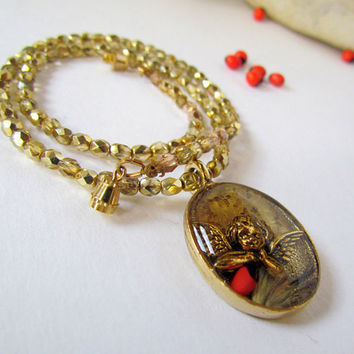 Resin Cherub Pendant Necklace golden beaded red by SandstarJewelry