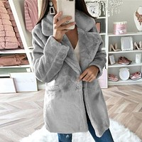 Wide Notched Collar Single Breasted Faux Fur Jacket.