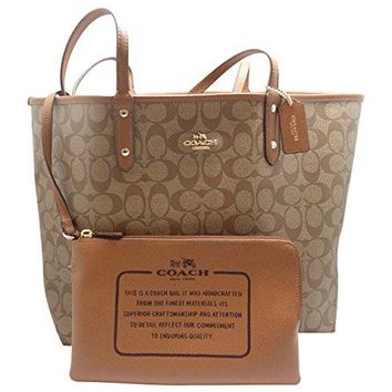 COACH REVERSIBLE SIGNATURE TOTE