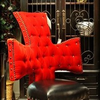 Cross chair, tufted red velvet and black leather seat