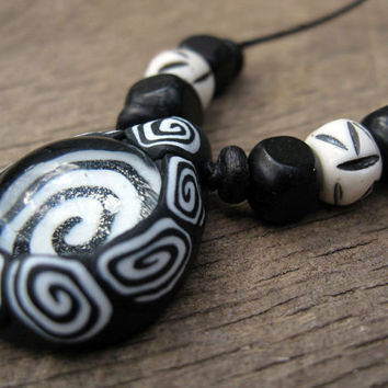 Mens pendant necklace, black and white, hypnos spiral design, polymer clay and glass with bone beads on thin cord, handmade, rave, tribal