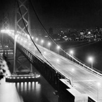 The Lights of Downtown San Francisco Twinkle Across the Bay Photographic Print at Art.com