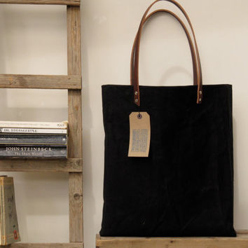 Oversized tote. Thick leather straps. Washed black canvas. Black/white cotton stripe lining.