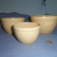 "Pottery Yellow Ware Nesting Bowls, Small Unmarked 4"" tall, 4.25"", 5.5"" and 6.5"" top dia."