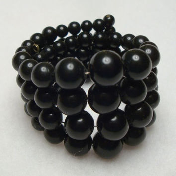 Black Memory Coil Expansion Bracelet 4 Rows Graduated Beads Vintage Jewelry