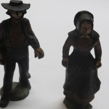 Amish man and woman couple metal old
