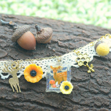 Woodland theme deer altered art charm bracelet, charms including deer, needle felt acorn, bee and flowers, whimsical jewerly, gift under 20