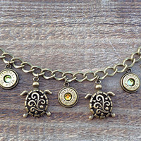 Bullet jewelry. Charm bracelet with bullet casings and turtles