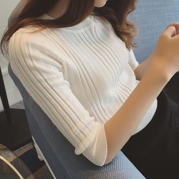 In the spring of 2017 new women's half sleeve knit turtleneck female sleeve head tight sleeve seven slim solid backing