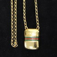 Vintage Gucci golden mini bottle necklace with embossed logo mark and webbing sherry line. Gorgeous rare masterpiece from 80s.