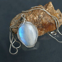 Moonstone pendant silver wire wrapped oval shape with a silver plated necklace