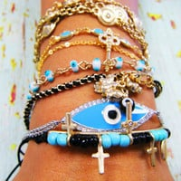 Gold plated bracelet with eye good luck and in the middle a crystal three gold straps