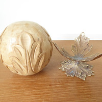 Carved wood sphere and brass leaf stand