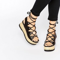 Kat Maconie Eva Black & Gold Lace Up Flatform Sandals
