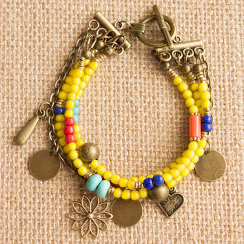 Gypsy Turquoise, Yellow, Red, Blue, Coral, and Brass African Beads Multi Strand Charm Bracelet