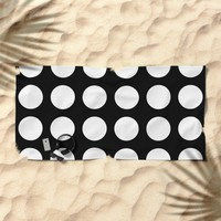 White polka dots in black background Beach Towel by byjwp