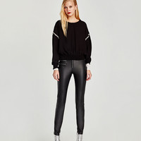 LEATHER EFFECT ZIPPED TROUSERS DETAILS