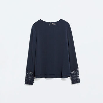 TOP WITH EMBROIDERED CUFF