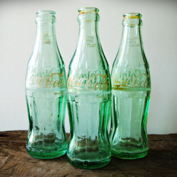 Set of Three Collectible Vintage Green Glass Coca-Cola Bottles from 1960 Embossed with Cities and States on the Bottom