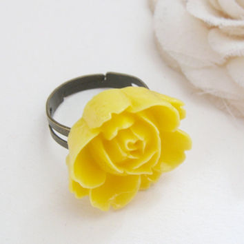 Adjustable bronze ring with yellow resin rose