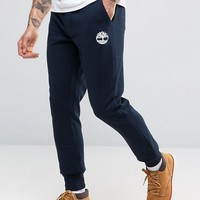 Timberland Slim Logo Cuffed Sweatpants In Navy at asos.com