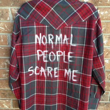 Plaid flannel shirt with slit shoulders and Normal People Scare Me written on the back